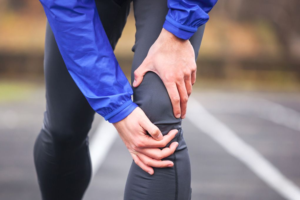 sharp pain in knee when walking and bending